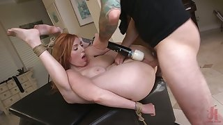 Spoiled busty redhead Lauren Phillips moans as her anus is stretched hard