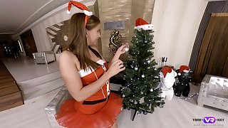 Sexy Azure Angel spends Xmas by fingering her wet pussy near Xmas tree