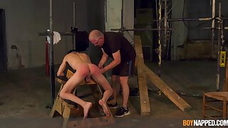 Twink endures old man's cock in brutal BDSM cam play