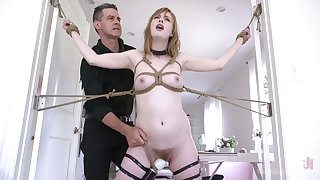 Lewd slender hoe Dolly Leigh gets a chance to experience breast bondage